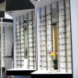 Row of glasses at an opticians - Stock Photo
