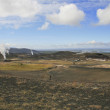 Geothermal landscape with steam columns — Stock Photo