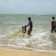 Fishermen cleaning nets — Stockfoto