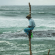 Local fisherman on a pole — Stock Photo