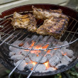 Grilling spare ribs on bbq — Stock Photo