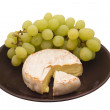 Cheese dessert with grapes. - Stock Photo
