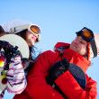 Girl and boy with snowboards - Stock Photo