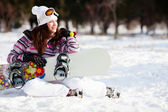 Girl with snowboard — 图库照片