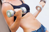 Girl with dumbell — Stock Photo