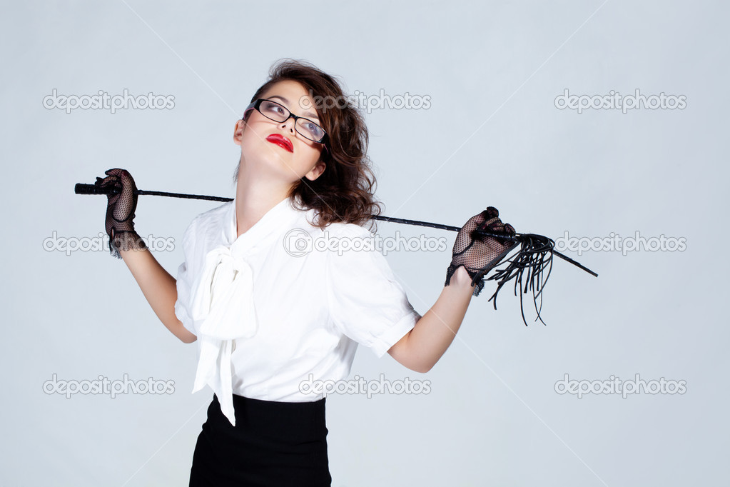 Strict  teacher with glasses and a whip — Stock Photo #12944885