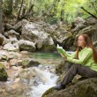 Girl with book near river — Stock Photo