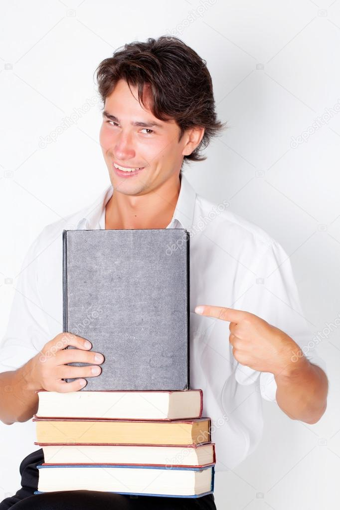 Young man with big books in studio — Stock Photo #13409829