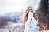 Girl in winter garden — Stock Photo