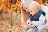 Mother with son in garden — Stock Photo