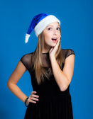 Girl in christmas hat — Stock Photo