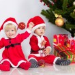 Stock Photo: Two children under christmas pine