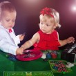 Boy and girl playing poker — Stock Photo