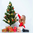 Stock Photo: Girl with christmas pine