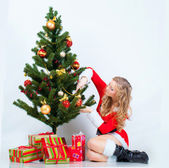 Girl with christmas pine — Stock Photo