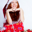 Redhead girl with presents — Stock Photo
