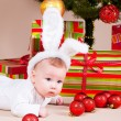 Stock Photo: Baby under christmas pine