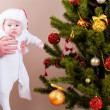 Baby near christmas pine — Stock Photo
