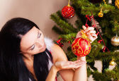 Woman in christmas dress — Stock Photo