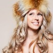 Girl in fur hat — Stock Photo