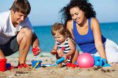 Family on the beach — Stock Photo