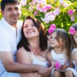 Family in rose garden — Stock Photo #24171081