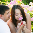 Two lovers in rose garden — Stock Photo