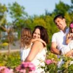 Family in rose garden — Stock Photo #24171237