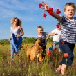 Family on the poppy meadow — Stock Photo