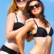 Girlfriends on the beach — Stock Photo