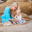 Mother with her baby on the beach — Stock Photo