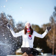 Girl playing with snow — Stock Photo