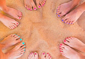 Woman feet on the sand — Stock Photo