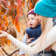 Woman with son in peach garden — Stock Photo