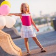 Little girl with balloons — Stock Photo #30659025