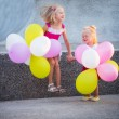 Two little girls with balloons — Stock Photo #30659287