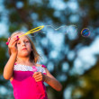 Little girl with bubbles — Stock Photo #30659315