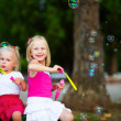 Two little girl with bubbles — Stock Photo #30659365