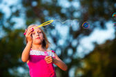 Little girl with bubbles — Stock Photo