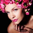 Woman with rose flowers hairstyle — Stock Photo