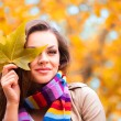 Young woman in autumn park — Stok fotoğraf