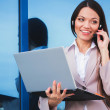 Businesswoman speaking the phone — Stock Photo
