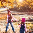 Two little girls in autumn park — Stock Photo