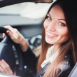 Woman driving the car — Stock Photo