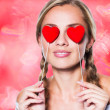 Girl with red heart shapes — Stock Photo