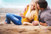Couple on the autumn beach — Stock Photo