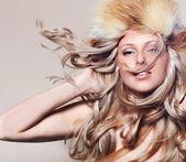 Girl in fur hat — Stock Photo