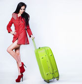 Beautiful woman portrait with suitcase — Stock Photo