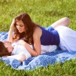 Young couple lying on the grass — Stock Photo