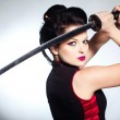 Woman with japan sword katana in hands — Stock Photo #41978561